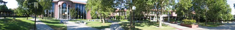 Photo of a panoramic view of the Learning Resource center building and the quad area around it.